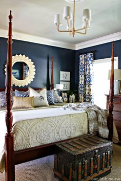 Striking deep blue walls in this master bedroom! Also, love the simple chandelier!