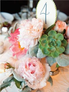 A mix of succulents and soft peonies.