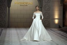 Off-the-shoulder-Princess. A model walks the runway during Pronovia's 50th anniversary bridal fashion show during 'Barcelona Bridal Week 2014' on May 9, 2014 in Barcelona, Spain.  (May 8, 2014 - Source: Miquel Benitez/Getty Images Europe)  http://www2.pictures.stylebistro.com/gi/Barcelona+Bridal+Week+2014+Day+4+cuH5tS2p4CCl.jpg