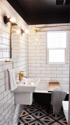 love the black ceiling white tile wall and patterned floor