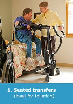 A caregiver uses the Rifton TRAM portable lift to execute a seated transfer of a middle-aged, heavyset woman from her bed into her wheelchair.