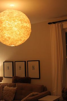 This is a standard Ikea light adorned with coffee filters; it looks like a full moon!