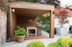 Modern timber framed extension and wooden decking covering | Livinlodge