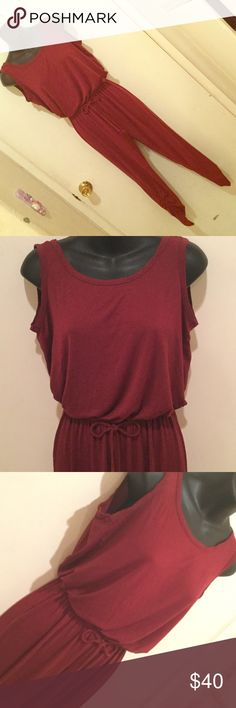 🔮NEW ITEM🔮 COMFY Burgundy Open-Back Jumpsuit 10/10 condition. Very soft material and light weight, perfect for spring/summer time!! You can tie the stretchy fitted styled waist. The bottoms of the legs are scrunched up with a stretchy material, and is a fitted cropped style. The back is open with a non-removable string connecting the upper back of the outfit, to prevent the outfit from slipping off of you. Pants Jumpsuits & Rompers