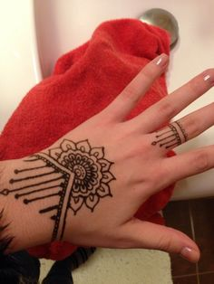 Simple mandala hand henna with matching ring