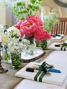 DIY Watercolor Art Party: Use ribbon to fasten a place setting of a blank mini canvas and paint brushes.