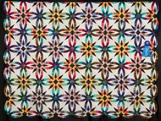 2015 Quilt Expo Quilt Contest, 1st Place, Category 1, Hand-quilted Bed Size-Pieced: Bali Wedding Star, Liz Heberlein, Fennimore, Wisc. quiltexpo.com