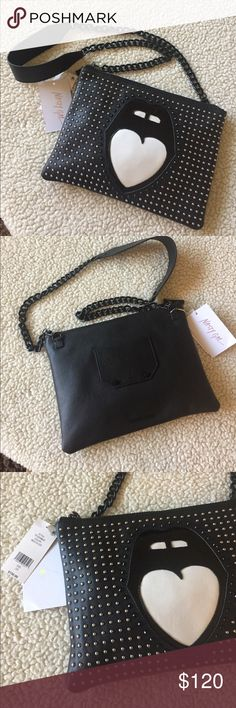 "NEW! NASTY GAL LEATHER ""MOUTH OFF"" BAG BRAND NEW! NASTY GAL LEATHER STUDDED ""MOUTH OFF"" CROSS BODY BAG-Approximate Measurements are 11"" X 8"", with an approximate strap drop of 19""..,,REAL LEATHER, & COMES WITH DUST COVER TO KEEP IT CLEAN..... Nasty Gal Bags Crossbody Bags"