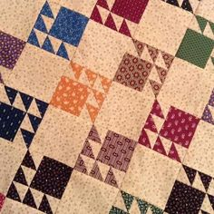 I see me using the Scrappy Bear Paw pattern from Marti and Me as an inspiration to make a quilt like this one...