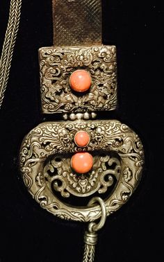 Silver belt pendant, coral inset, Mongol 19th century. Private collection
