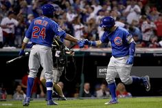 Javier Baez #9 of the Chicago Cubs celebrates with Dexter Fowler #24 after hitting a solo home run during the fifth inning against the Cleveland Indians in Game Seven of the 2016 World Series at Progressive Field on November 2, 2016 in Cleveland, Ohio.