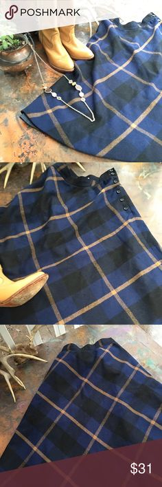 Beautiful vintage plaid wool midi skirt Great blue & tan plaid wool midi skirt, it's lined & buttons on the hip. Adorable addition to any vintage wardrobe!! Vintage Skirts A-Line or Full
