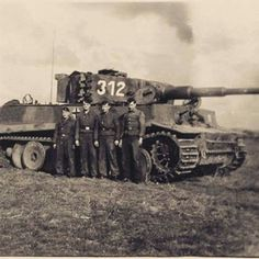 4 crew members getting a photo with their Tiger 1 numbered 312 during a break in the fighting.