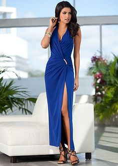Draped and wrapped at front with gold hardware detail at front waist. Halter style with surplice neckline.