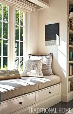 Sandwiched between floor-to-ceiling bookshelves, a sunny window seat provides a . Sandwiched between floor-to-ceiling bookshelves, a sunny window seat provides a great place to read Interior Design, Home, Interior Design Living Room, Window Sill Decor, Floor Seating, Bedroom Seating, Bedroom Design, Floor To Ceiling Bookshelves, Bay Window Seat