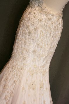 Jenn's Low Back Beaded Mermaid Wedding Dress - Avail & Company  Gorgeous silver beaded and embroidered wedding dress made of satin and illusion.  Perfect for a beach, country, fairy tale, fall, silver, spring or vintage style wedding.  A gorgeous sexy, flowy dress!