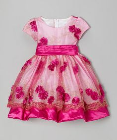 Add a touch of elegance to any occasion with this exquisite dress. With its big satin bow, easy back zip and sheer overlay skirt covered in shimmering roses, this little gem possesses serious powers of enchantment.