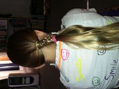 A slight variation of the Chinese Staircase ponytail....we like it! (A LOT!!)