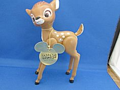 "A 8 tall Bambi made from hard plastic and has movable legs and tail. Still has the ""Bambi, Walt Disney Production"" tag around it's neck and is in the original bag."