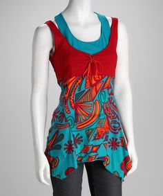 Bold and bright colors make up a funky pattern, giving this sidetail tank tons of personality. Slip into this top and stay ahead of the season's most stylish trends.Measurements (size S): 32'' chest (measured 1'' below arm); 29'' long from high point of shoulder to hem100% cottonHand wash; line dry