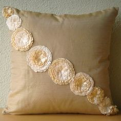 Pillow Cover is made using a Beige Gold color Art Silk Dupioni Fabric embroidered beautifully with satin ribbon flowers scattered to create a line.    The back of the pillow is the same Beige- Gold color silk dupioni fabric with a flap covered zipper for clean look and easy removal.    Pillow Cover Size - 16 x 16 inches.    Other Size Options are also available in this Design.  18x18 inches - http://www.etsy.com/listing/53406761/fantasy-flowers-throw-pillow-covers  20x20 inches…