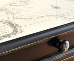 Mod podge a map onto a side table or desk.  In our house it would most definitely be a map of Middle Earth, or Prydain or Randland....