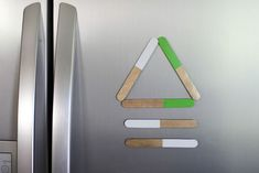 What's all the rage these days in the world of fridge art? Stick Magnets! Steps for the kiddos to make them are here.