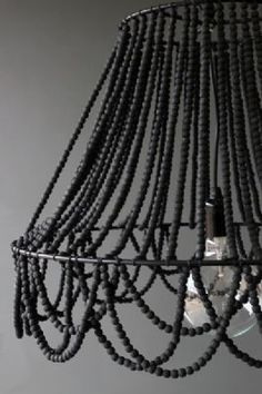 DIY black beaded chandelier with lamp frame. Can also use hanging plant basket from the dollar store, as a frame & add a hanging pendant light inside. It doesn't have to be black, just the idea is super cute, to make your own chandelier.