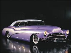 1953 Buick Skylark convertible with long, flowing body lines. And, dig this: it's lavender.   Owned by James Hetfield, the growling, menacing-looking lead singer / guitarist from the heavy-metal band, Metallica