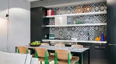 Funky patterned splash back gives life to a small apartment kitchen