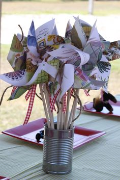 Pinwheels made from Golden Book pages. ** I like the ribbons on these
