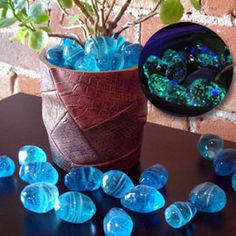 "Glowing Moon Rocks Illuminate a pathway, flowerbed or aquarium! Light up a walkway, container plant or fish tank with glow-in-the-dark moon rocks! The smooth glass ""stones"" contain luminescent crystals that store the sun's energy during the day and glow softly at night. A great outdoor accent!"