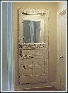 Mirror Door | An old exterior door fitted with a mirror on the top half and mounted to the wall | http://www.decorating-ideas-made-easy.com/cottage-style-decorating-ideas.html#