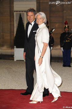 Christine Lagarde and her husband at the Elysee Palace last night for a dinner in honor of the Lebanese President.  Brilliant AND chic!  I love her brains and fashion sense...