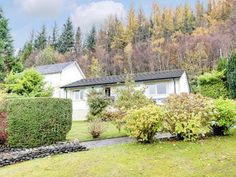 Enjoy a cottage holiday at Dunbheag Cottage. Located just 5 miles to the beach, surrounded by magnificent scenery this beautifully furnished property makes an ideal relaxing break. Dog Friendly Holidays, Garden Stand, Loch Lomond, Forest Park, Dog Friends, Cottages, Scotland, National Parks, Plants