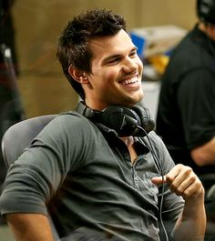 CREATIVE APPROACH Also at Seacrest Studios: Taylor Lautner, who shows off his pearly whites Friday during his chat with the radio host.