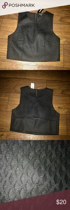 NWT Express crop top NWT, black Express crop top. Back has a horizontal slit. Thick material. Size zipper. 100% polyester. Express Tops Crop Tops
