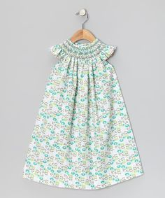 Nothing says prim and polished quite like intricate smocking and embroidery. This frock has both, with a swing silhouette and darling angel sleeves for a look that's airy, adorable and perfect for everything from backyard adventures to social soirees. 65% polyester / 35% cottonMachine washMade in El Salvador