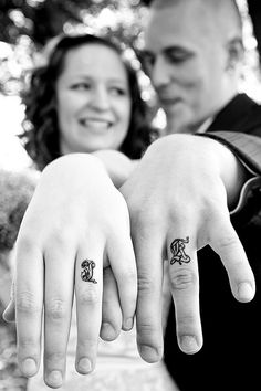 wedding ring tattoos. My husband and I have the eternity symbol on our fingers! To me it's  more meaningful than a ring (which we both have). It can't be removed like a ring and the whole symbol of death do you part (eternity) hasten lost in a lot of marriages what an awesome reminder <3