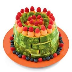 Perfect cake!    Ingredients            Large seedless watermelon            Other fresh fruit, such as melon balls, kiwi slices, and berries    Instructions            Start by slicing the watermelon into wedges and then arrange them in a stack of circles (rinds facing out) to create a cake shape, as shown. Decorate the cake with the other fruits.