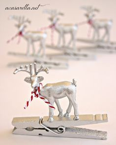 Reindeer gift toppers - Make w/ craft store figures & clothespins- attach w/ hot glue- spray w/ silver or gold paint- tie w/ butcher twine.