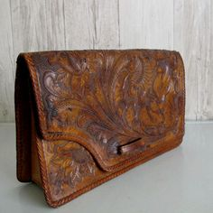 I'm obsessed with vintage tooled leather bags.
