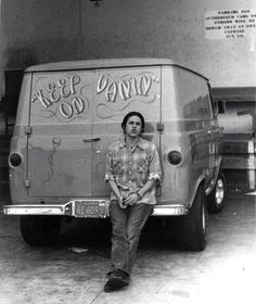 Vintage Ford Econoline Van and it's chick magnet owner.