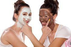 Two smiling young women with masks stock photo