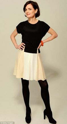 Love this!  Black top, black tights, black pumps, and a fun white skirt!  That's Not My Age