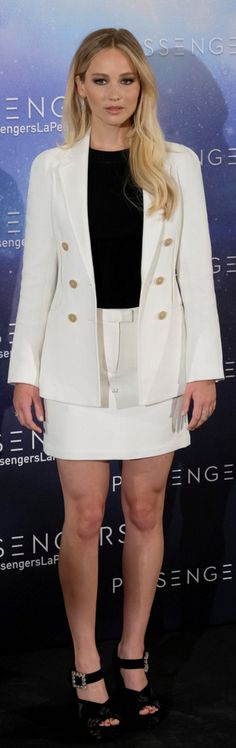 Who made Jennifer Lawrence's  double breasted blazer, jewelry, white mini skirt, and black crystal sandals?