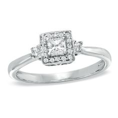 love the princess cut surrounded by smaller circle diamonds.