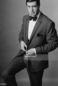 A male model poses in a dinner jacket and bow tie, circa 1960. A fashion shoot for Town magazine.  Photo by Duffy