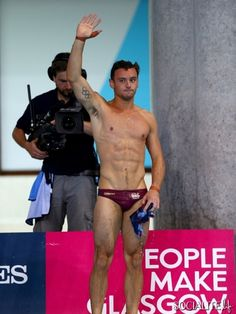 EDINBURGH, SCOTLAND - AUGUST 02: Tom Daley of England celebrates poolside after winning the Gold medal in the Men's 10m Platform Final at the Royal Commonwealth Pool during day ten of the Glasgow 2014 Commonwealth Games on August 2, 2014 in Edinburgh, United Kingdom. (Photo by Clive Rose/Getty Images)