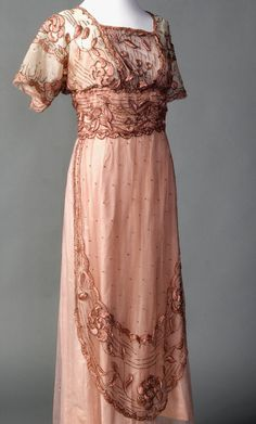 Evening Gown c1911-1915 French Repository Number: 2000.2.3 Materials: Silk netting, silk floss, glass beads, silk taffeta